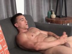 muscular-hunk-jerks-off-until-cumspraying