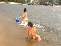 Two Pretty Girls Get Naked And Have Fun With A Blue Ball On