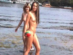 playful-young-vixens-engage-in-naked-watersports-on-the-bea