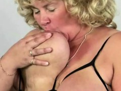 blonde-mature-playing-with-her-big-boobs