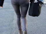 Attractive young chick walks down the street in her skinny