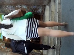 curvy-young-bimbo-wears-a-sexy-skirt-that-barely-covers-her