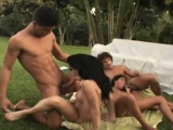 Two hung studs enjoy their time with a buxom tranny and a sultry girl