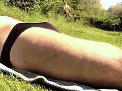sunbath-in-a-field-in-brief-that-is-black