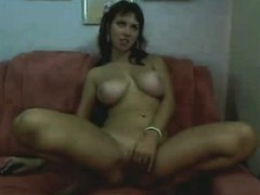 busty-masturbates-with-her-finger-on-the-couch