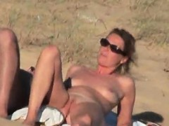 Lustful Couple Caught Naughty On The Nude beach