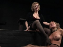 restrained sexy milf pissing in bdsm action