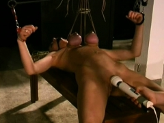 woman-stands-with-her-tits-tied-up-in-sexy-slavery-scenes