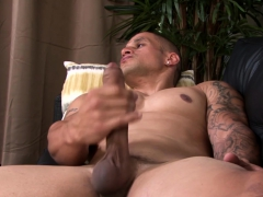 tattooed-military-guy-working-on-his-long-hard-cock