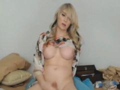 pretty-lovely-shemale-massturbates-her-cock-hard