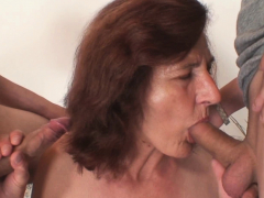 old lady blowing and fucking two cocks at once