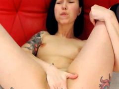 tattooed brunette gets busy with a vibrator