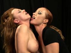 redhead-lezdom-dominates-over-bound-babe