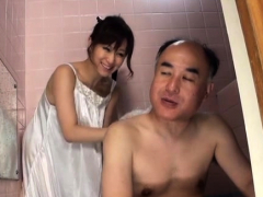 Japanese playgirl shows off tits and gives irrumation