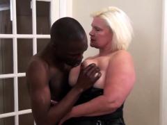 Grandma with big boobs sucks black cock