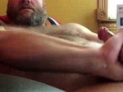 sexy-bear-stroking-his-thick-cock-until-eruption