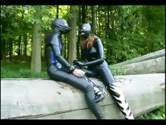 two-chicks-in-latex-pleasing-each-other