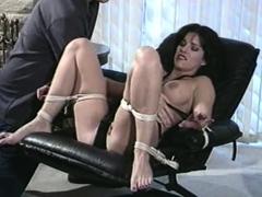 Sexy brunette enjoys a vintage bdsm fuck