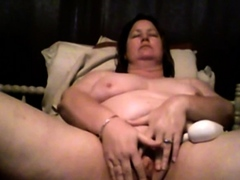 Chubby Sandy teases and pleases herself