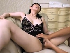 Redhead in sexy lingerie fingering pussy
