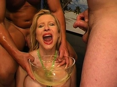 Busty darling gets vagina and face pissing from 2 fellows