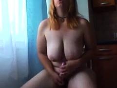 Amateur chubby redhead plays on cam