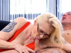 MATURE4K. Mature blonde grabs thick penis and has a lot